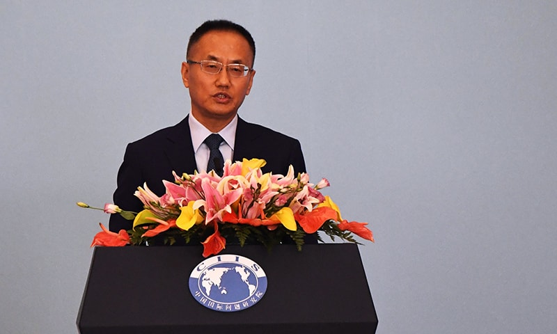 Assistant Minister of Foreign Affairs Chen Xiaodong delivers a speech during the Middle East Security Forum at the Diaoyutai State Guesthouse in Beijing on November 27. — AFP