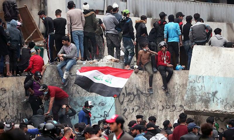 Iraq protesters block roads to press reforms, five shot dead
