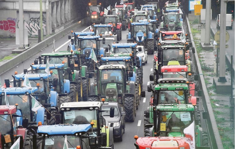 Paris: French farmers steer their tractors on a ring road at Porte de Champerret.—AFP