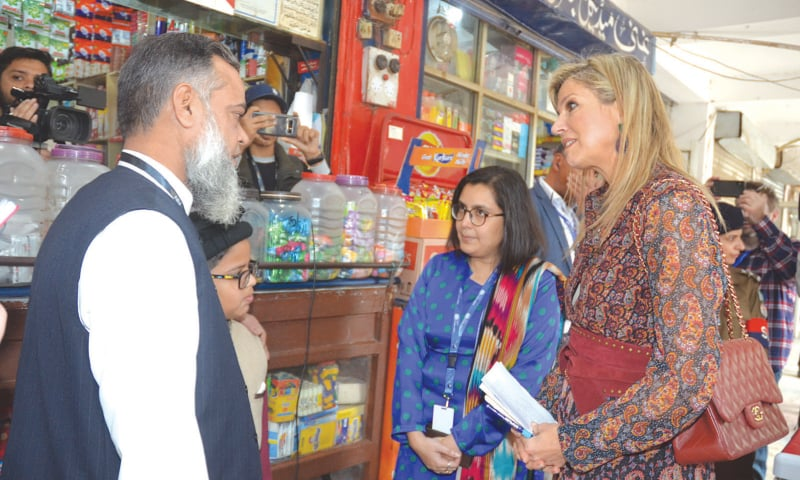 UN Secretary General's Special Advocate for Inclusive Finance for Development Queen Maxima of the Netherlands speaks to shopkeepers at Ghalib Market in Gulberg on Wednesday.—Dawn