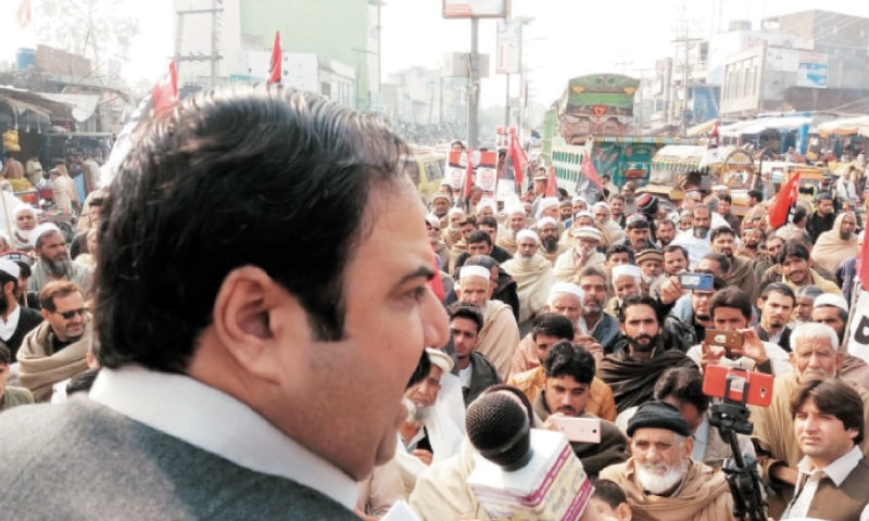 Sikandar Sherpao addresses a protest rally in Swabi on Thursday against government policies. — Dawn