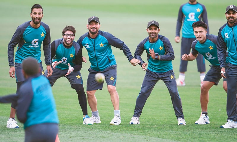 ADELAIDE: Pakistan cricketers take part in a training session at the Adelaide Oval on Thursday.—AFP