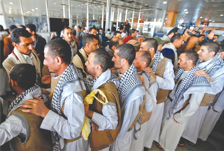SANAA: Yemeni prisoners pictured upon arrival at the airport.—AFP