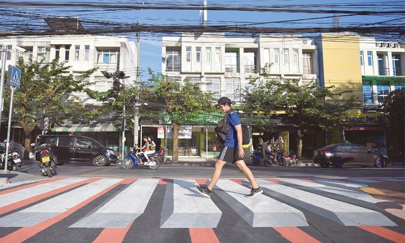 BANGKOK: A man walks on a 3D zebra crossing.—Reuters