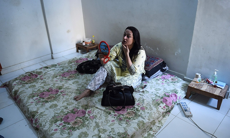 In this picture taken on October 16, transgender beautician Bebo Haider gets ready in her home to go to work in Karachi. — AFP