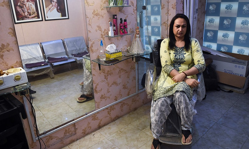 In this picture taken on October 15, transgender beautician Bebo Haider speaks during an interview in her beauty parlour in Karachi.  — AFP