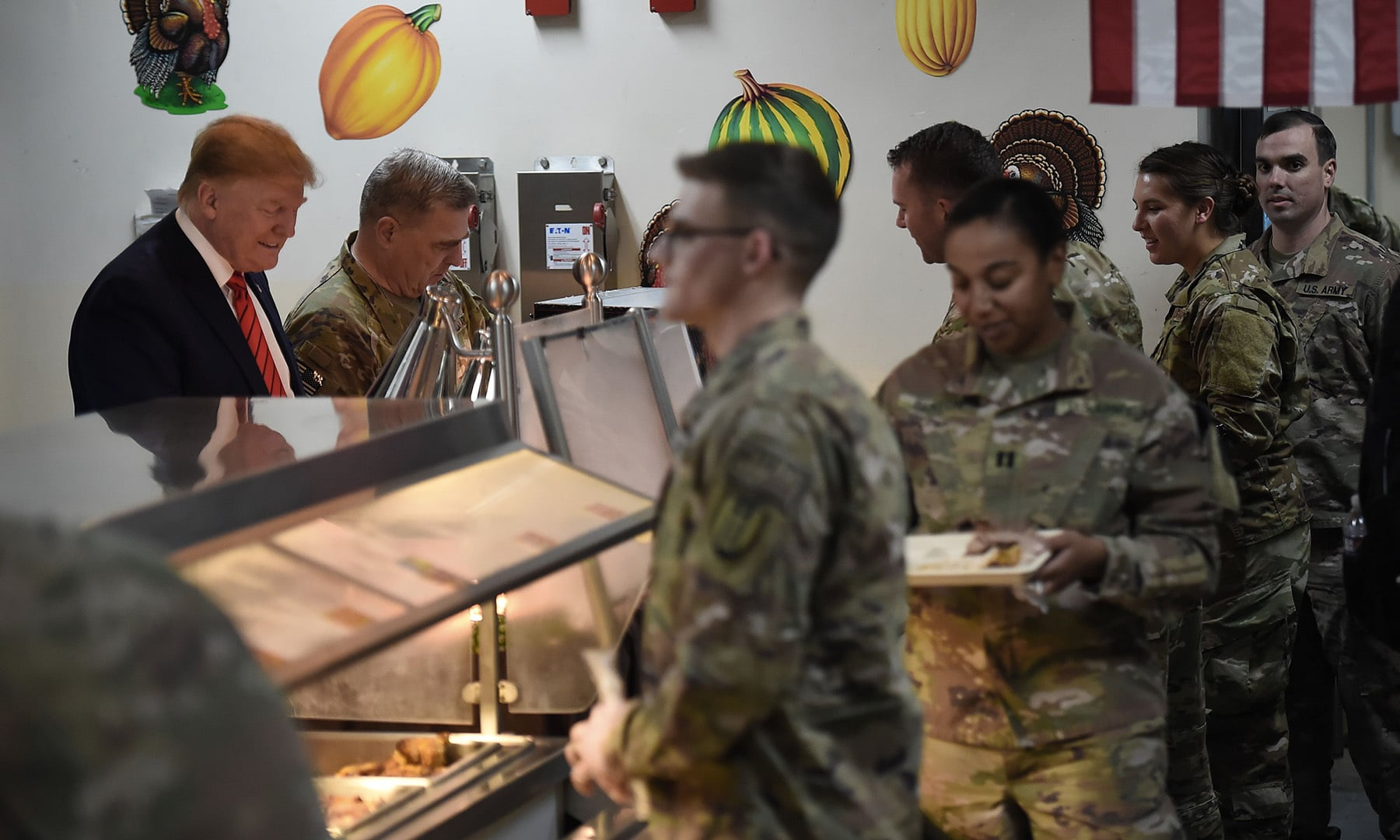 US President Donald Trump serves Thanksgiving dinner to US troops at Bagram Air Field during a surprise visit on November 28 in Afghanistan. — AFP