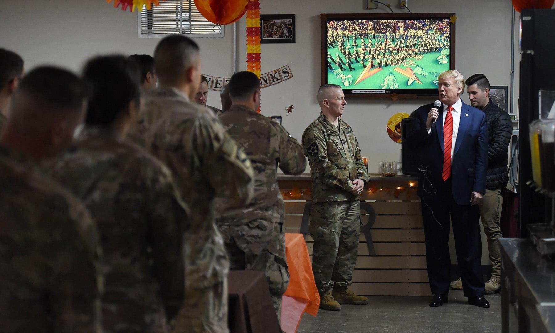 US President Donald Trump speaks to US troops at Bagram Air Field during a surprise visit on November 28 in Afghanistan. — AFP
