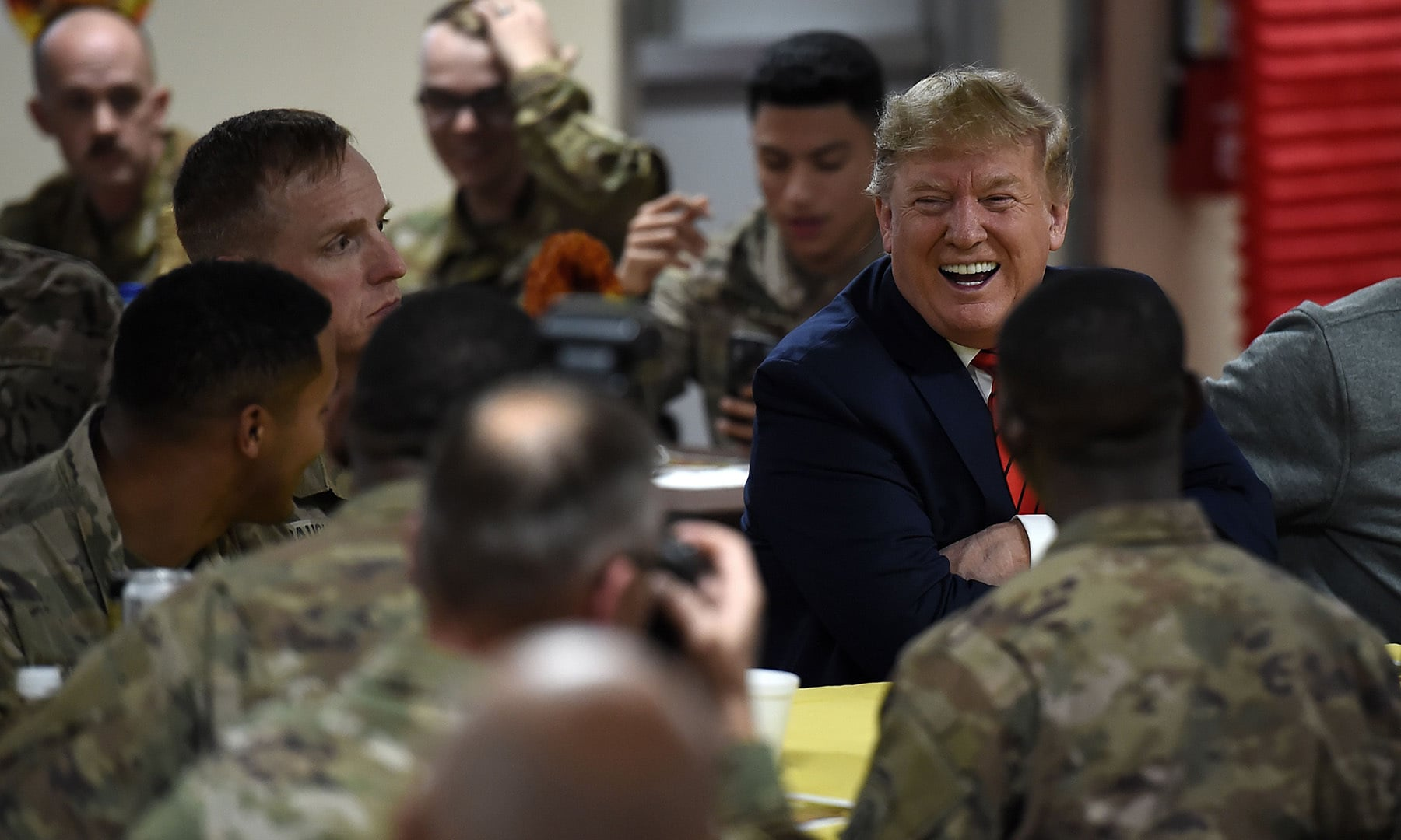"""I've just come from serving Thanksgiving dinner to some of you [...] and we had a good time."" Trump joked that he had just started eating when he was called away, and didn't even get to taste his turkey.  — AFP"
