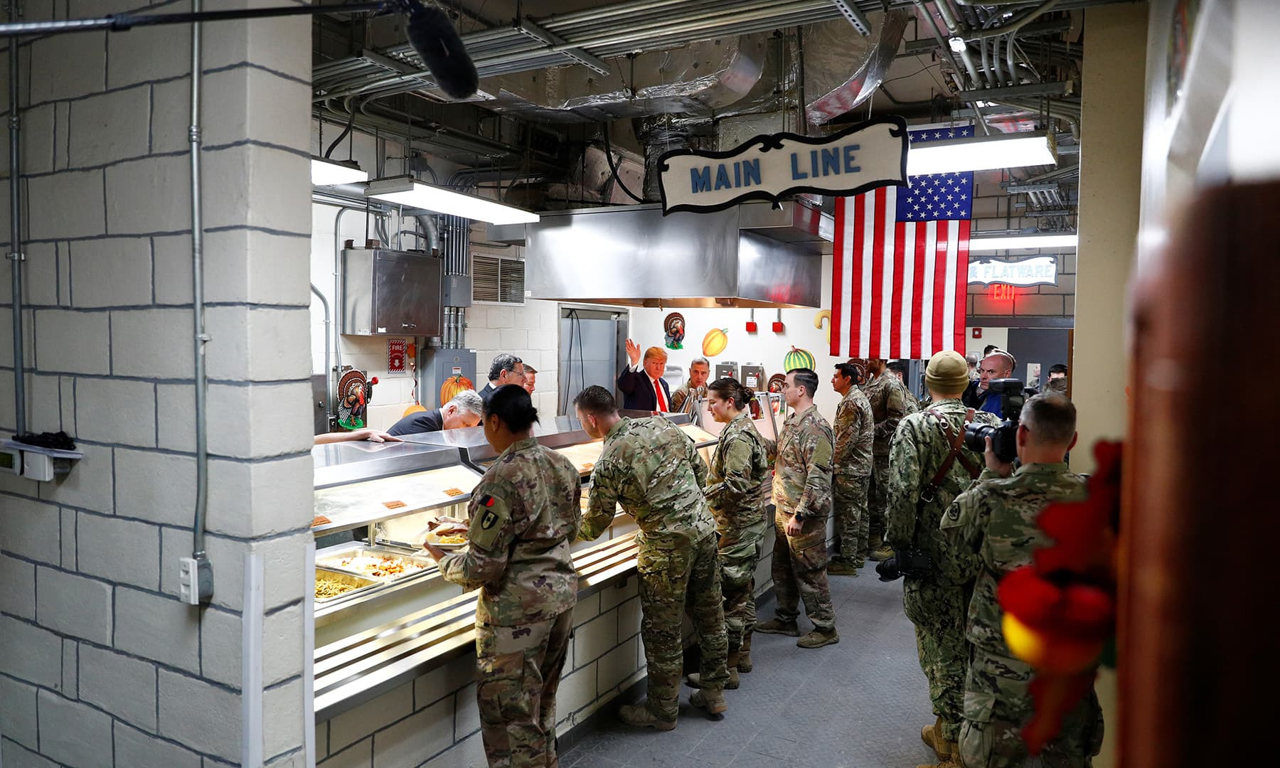 US President Donald Trump serves US troops food at a Thanksgiving dinner event during a surprise visit at Bagram Air Base in Afghanistan on November 28. — Reuters