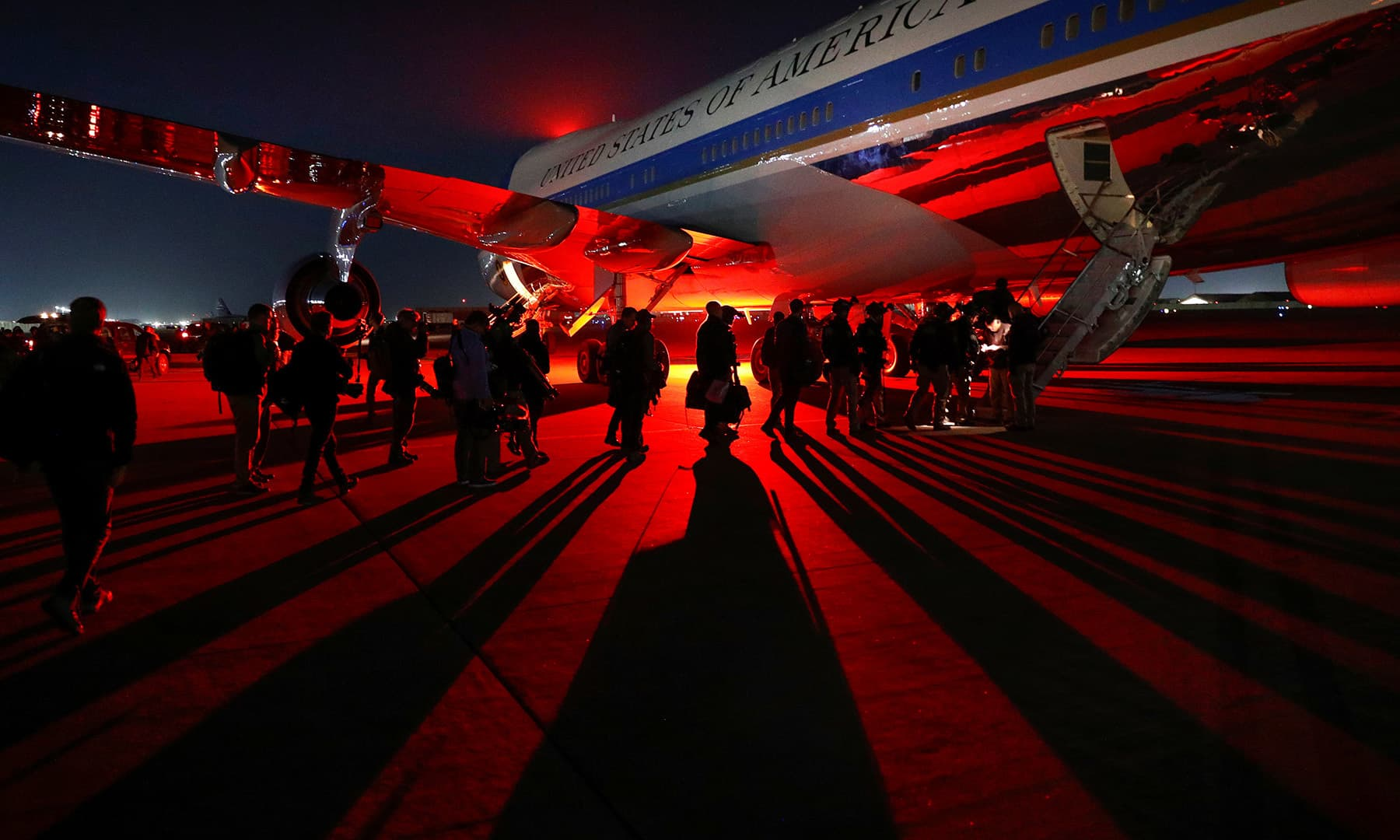 Members of the news media, US Air Force and US Secret Service line up to enter Air Force One, following US President Trump's remarks to US troops in an unannounced visit to Bagram Air Base, Afghanistan on November 28. — Reuters