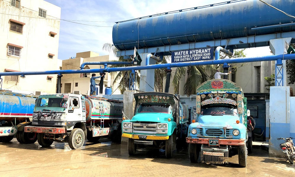 Tankers being filled up at the now regularised NIPA hydrant in Karachi. — Photo by Zofeen T. Ebrahim