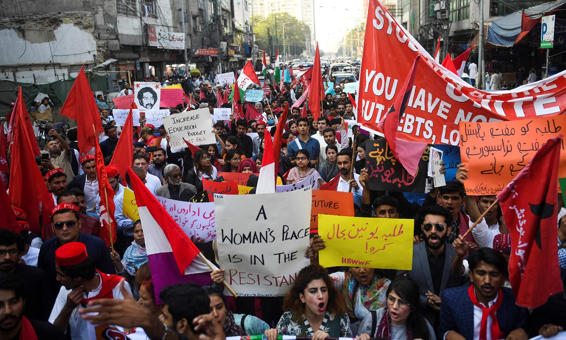 The streets of Karachi turned red with communist posters and flags in the protest march on Friday. — AFP