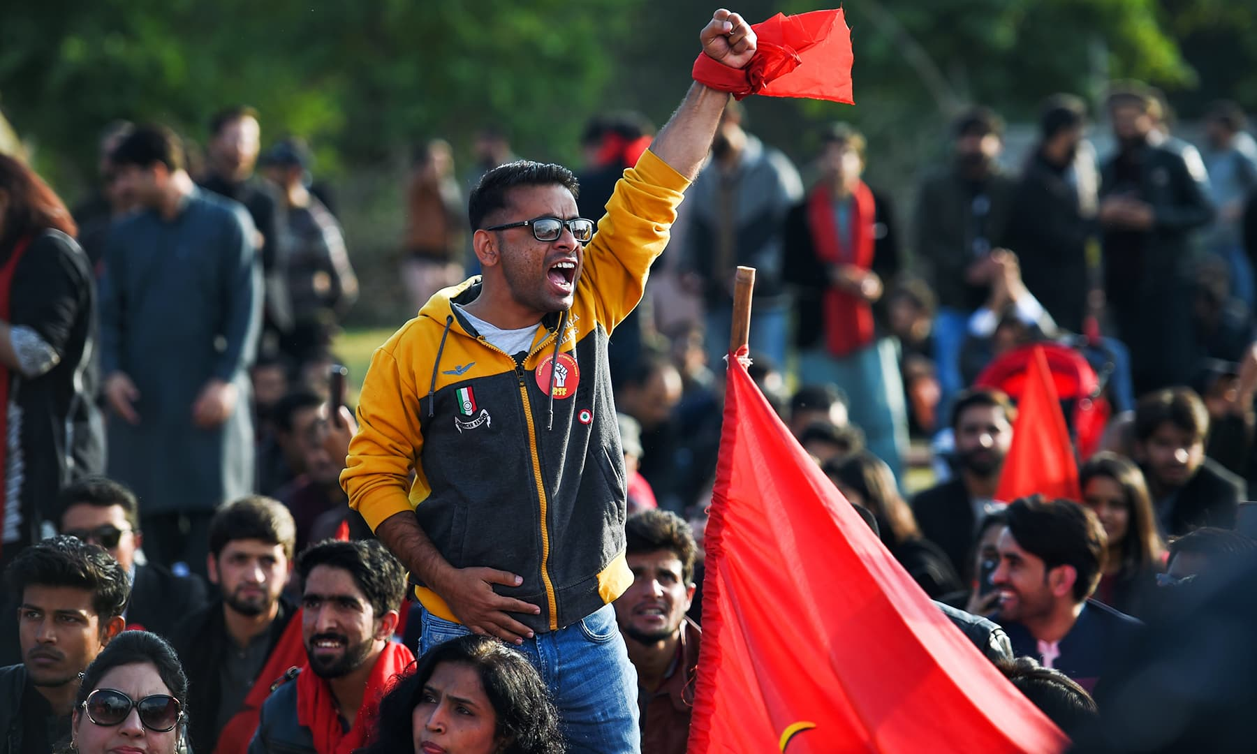 Students shout slogans demanding their right to student unions, in the march in Karachi on Friday. — AFP
