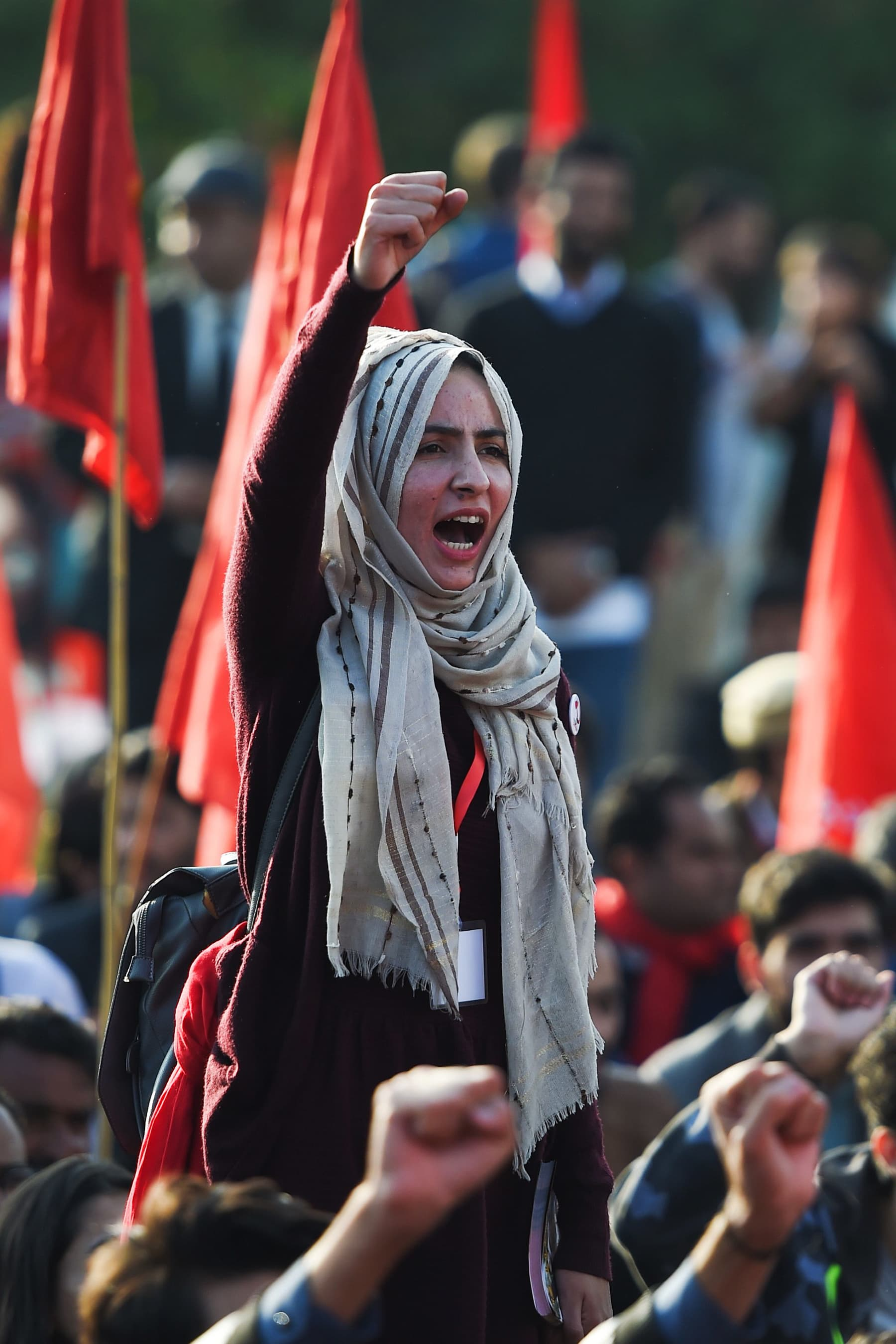 A girl shouts slogans during the protest rally in Islamabad on Friday. — AFP