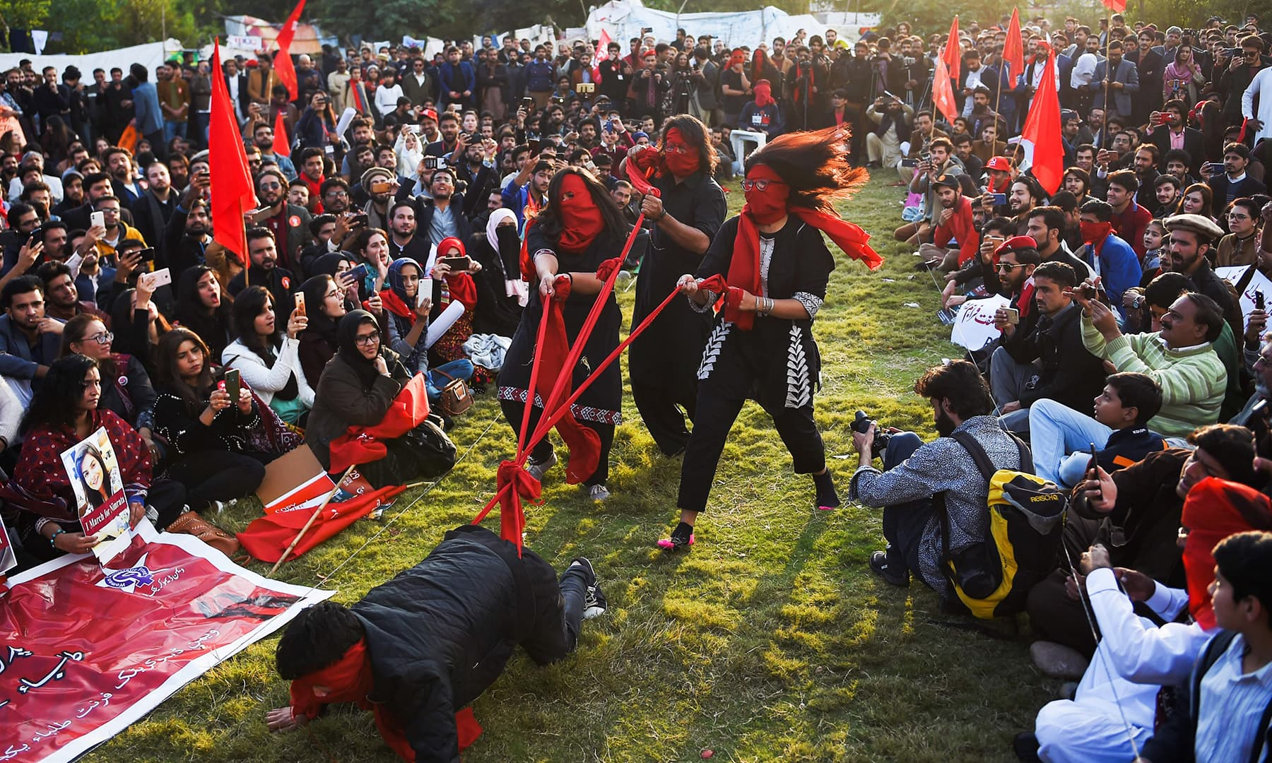 Students putting up a performance to demand better education facilities, in Islamabad on Friday. — AFP