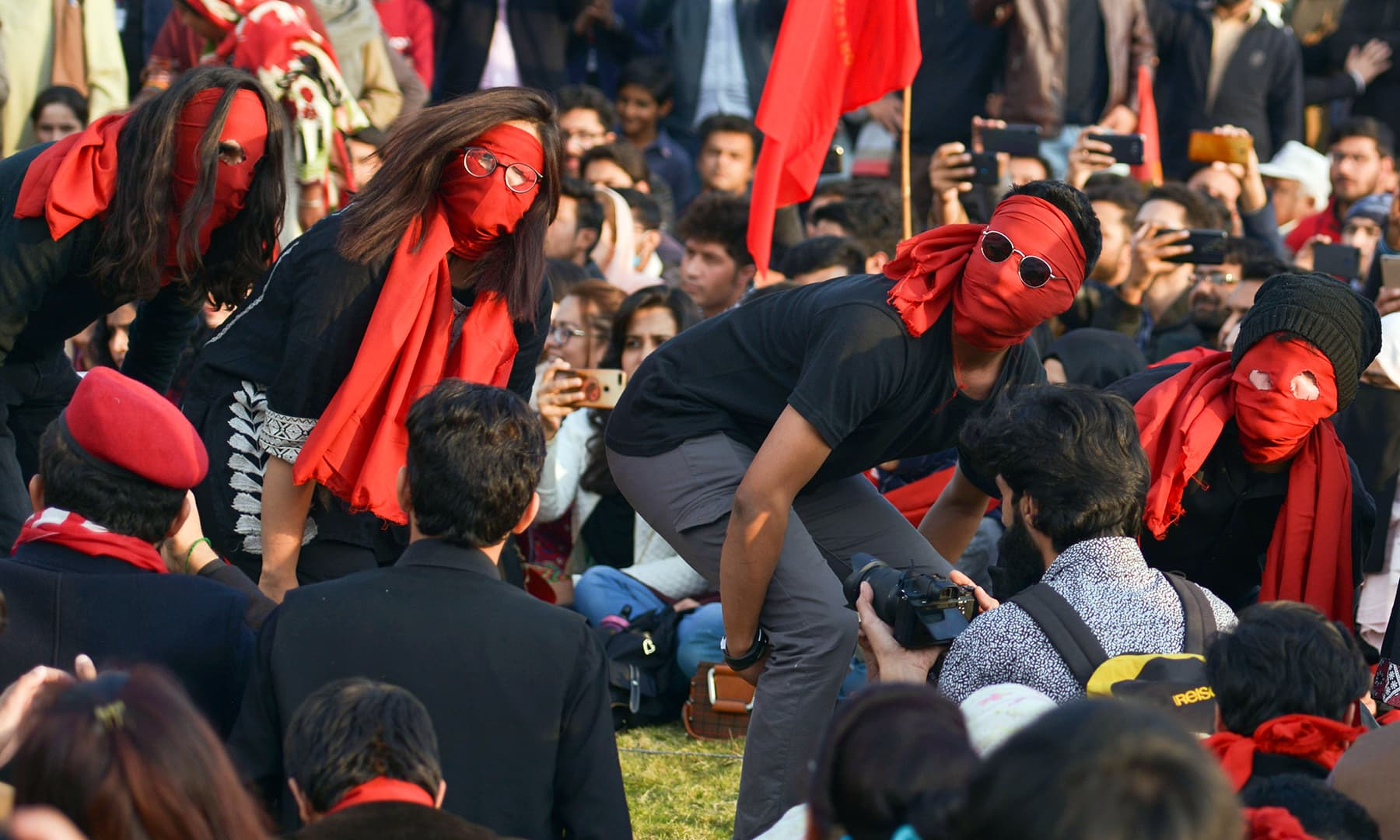 A close up of the student participants performing an act during the protest in Islamabad on Friday. — AFP