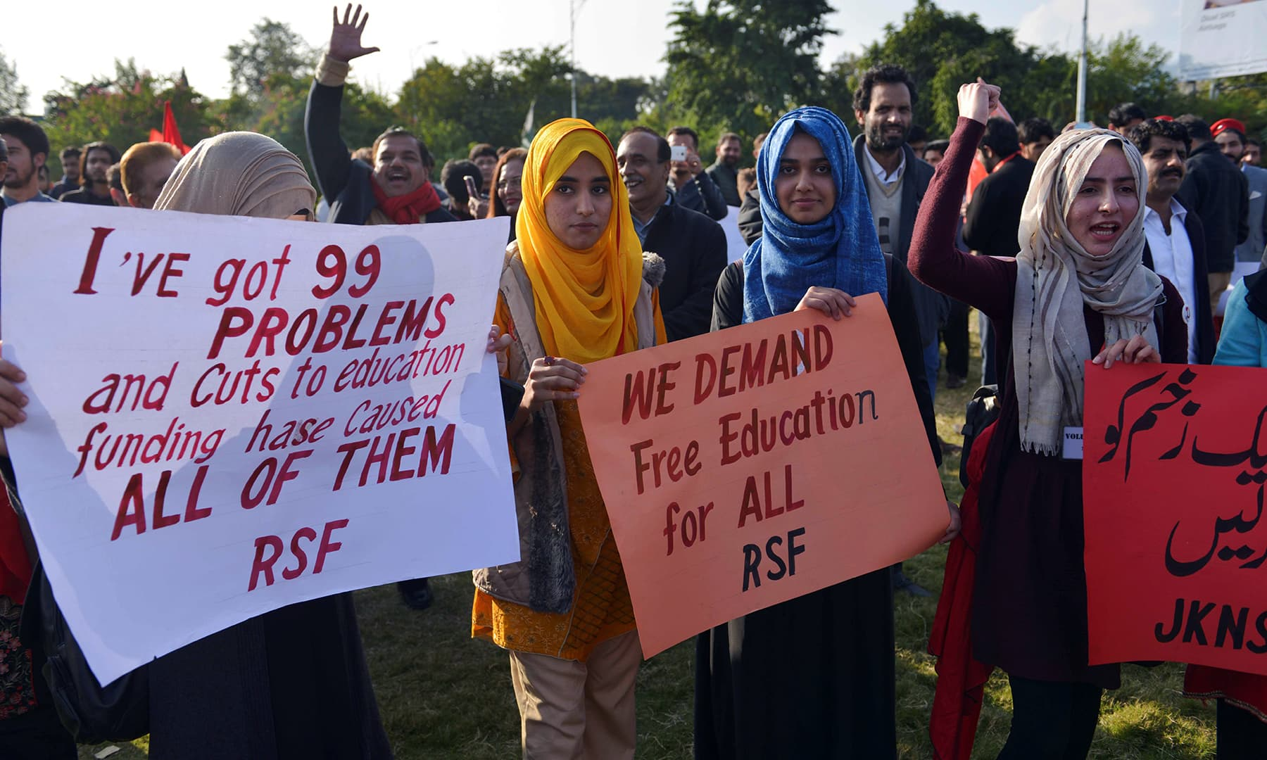 Students display their demands on placards during the protest in Islamabad on Friday. — AFP