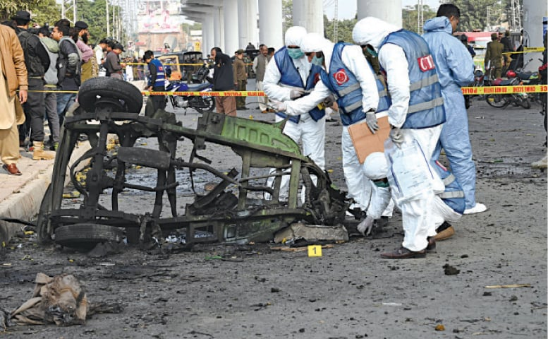 CTD officials collect evidence from the blast site near Chauburji. — White Star
