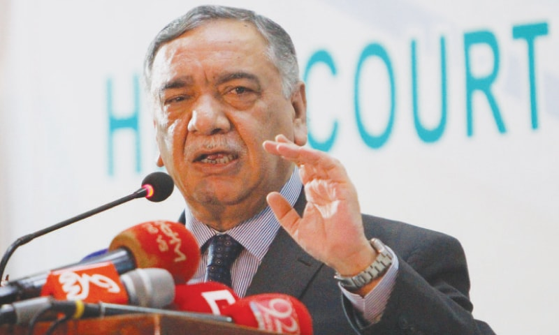 Chief Justice of Pakistan Asif Saeed Khosa gestures as he addresses lawyers at the High Court Bar Association in Multan on Friday.—Reuters