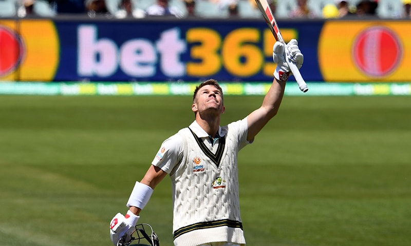 Australia'a batsman David Warner celebrates reaching double century on day two of the second cricket Test match between Australia and Pakistan in Adelaide on Saturday. — AFP