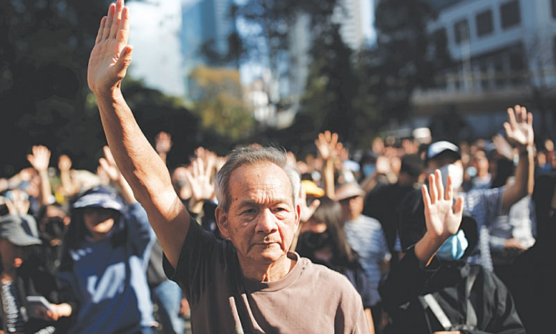 HONG KONG: An elderly man raises his hand at an anti-government protest on Saturday.—Reuters