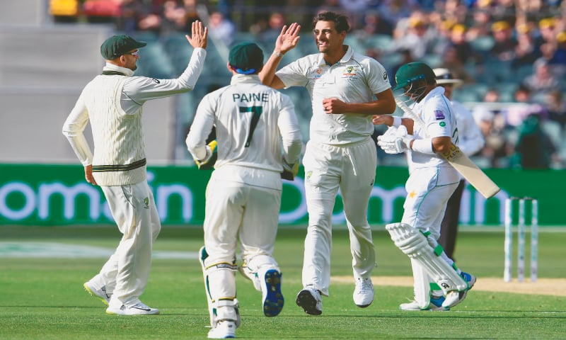 PAKISTAN opener Imam-ul-Haq trudges off after being dismissed by Australian paceman Mitchell Starc (second right) during the second Test at the Adelaide Oval on Saturday.—AFP