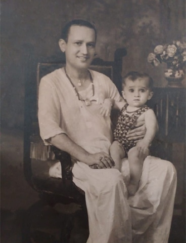 Ellicott holding Abdul Sattar Chandio