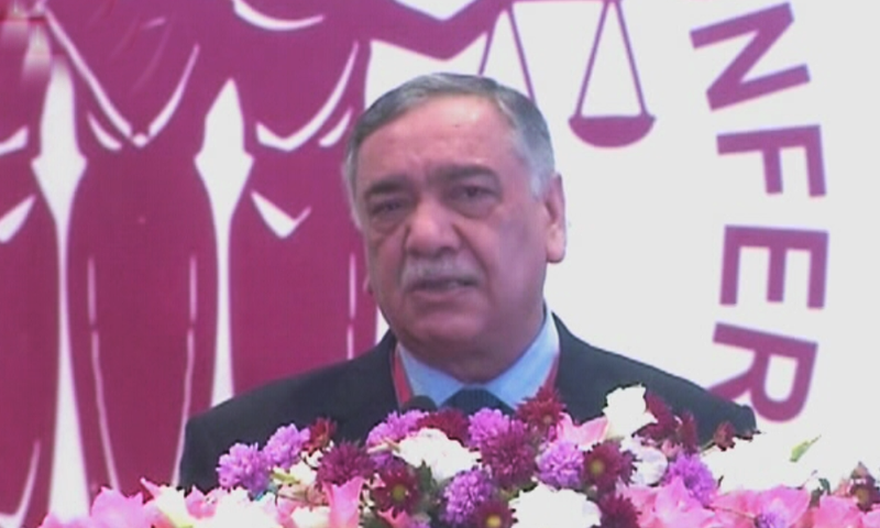 Chief Justice Asif Saeed Khosa addresses the 'Women Judges Conference' in Lahore on Sunday.  — DawnNewsTV
