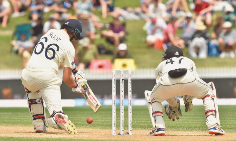 England captain Joe Root plays a defensive shot as New Zealand wicket-keeper BJ Watling looks on during their second Test at Seddon Park on Sunday.—AFP