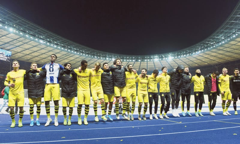 BERLIN: Borussia Dortmund players celebrate winning the Bundesliga match against Hertha Berlin at the Olympiastadion.—Reuters