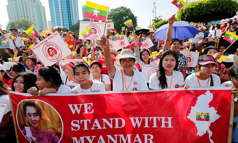 People gather to rally in support of Myanmar State Counsellor Aung San Suu Kyi before she heads off to the International Court of Justice (ICJ), in Yangon, Myanmar on December 1. — Reuters