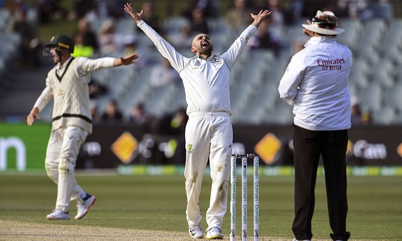 Australia's spinner Nathan Lyon (C) reacts after appealing successfully for an LBW decision against Pakistan's batsman Yasir Shah on the fourth day of the second Test cricket match in Adelaide on December 2. — AFP
