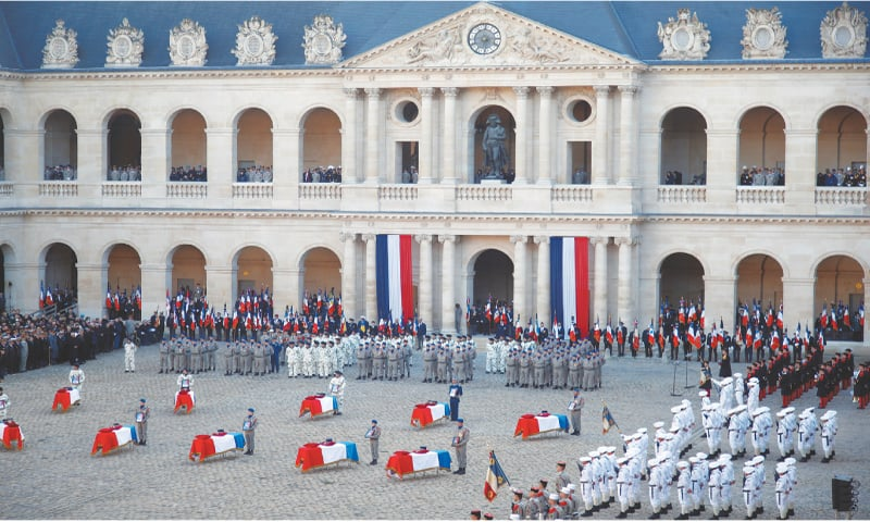Paris: The flag-draped coffins of the 13 French soldiers killed in Mali are seen during a ceremony on Monday.—Reuters