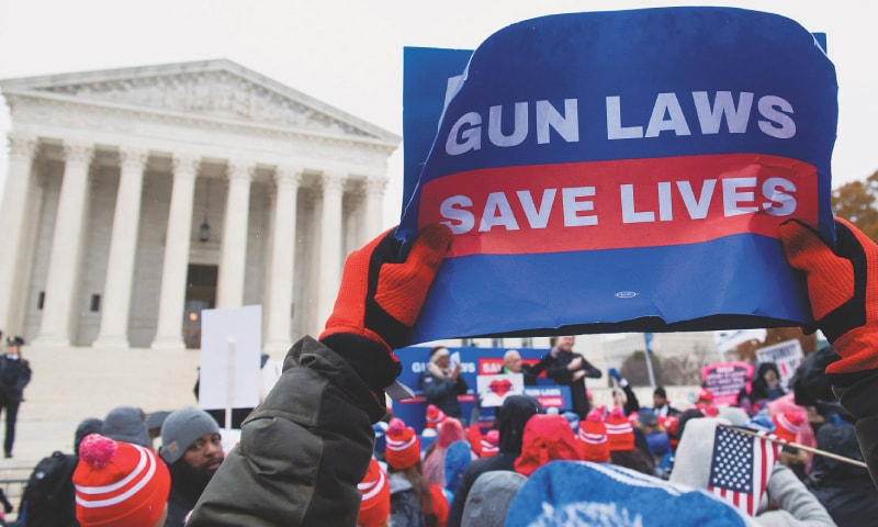 Washington: Supporters of gun control hold a rally outside the US Supreme Court on Monday.—AFP