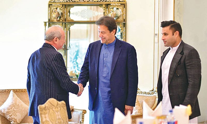 ISLAMABAD: Prime Minister Imran Khan shakes hand with Egyptian businessman Naguib Sawiris.—Online