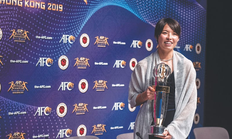 Olympique Lyonnais' Japanese footballer Saki Kumagai poses at a press conference after being awarded with the Asian Football Confederation Women's Player of the Year award on Monday. — AFP