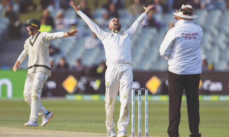 AUSTRALIAN off-spinner Nathan Lyon reacts after a successful LBW appeal against Pakistan's Yasir Shah during the second Test at the Adelaide Oval on Monday.—AFP