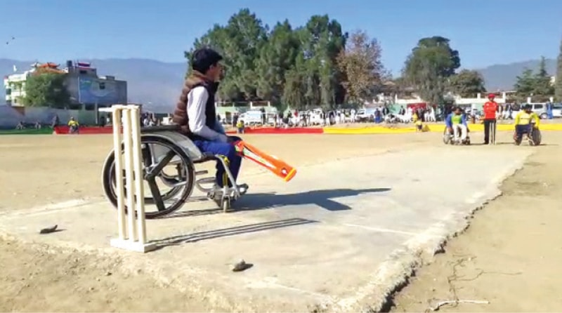 Final match of the cricket tournament of physically-challenged teams underway in Timergara on Monday. — Dawn