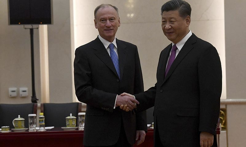 China's President Xi Jinping shakes hands with Russia's security council secretary Nikolai Patrushev at the Great Hall of the People in Beijing on Monday. — AP