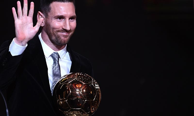 Barcelona's Argentinian forward Lionel Messi reacts after winning the Ballon d'Or France Football 2019 trophy at the Chatelet Theatre in Paris on December 2. — AFP