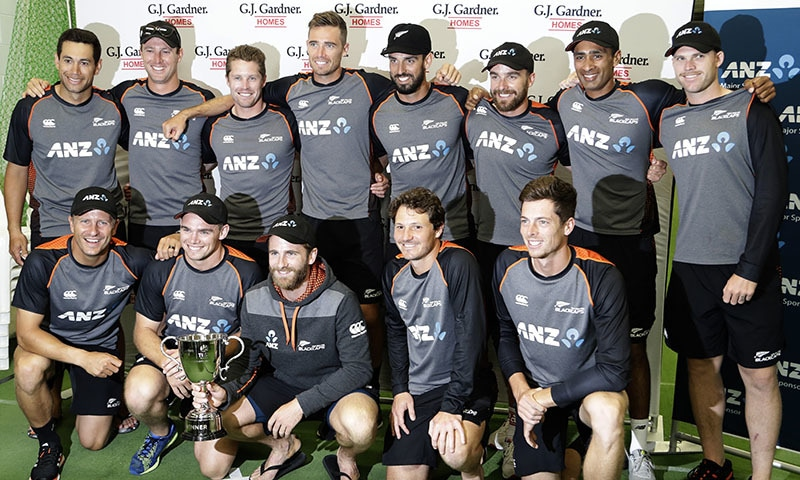 New Zealand players pose for a team photo with the trophy following play on the final day of the second cricket test between England and New Zealand at Seddon Park in Hamilton, New Zealand, on Dec 3. — AP