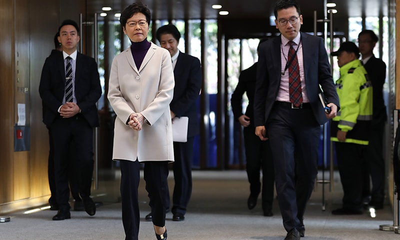 Hong Kong leader says new US law, violence will harm economy