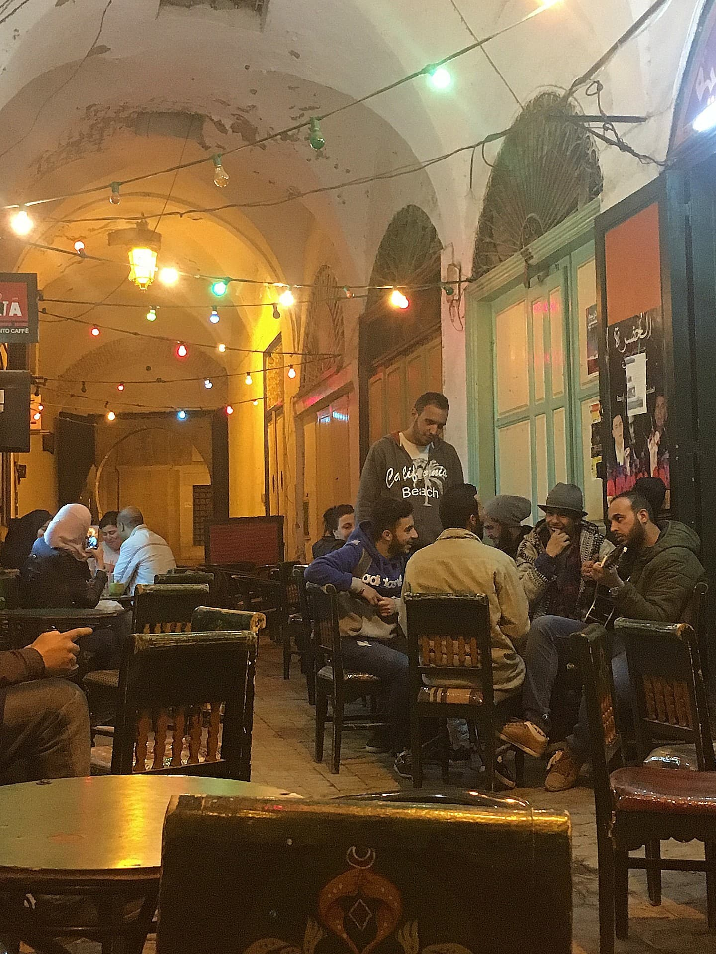An impromptu musical performance by a group of young men at Café Chaouachine.
