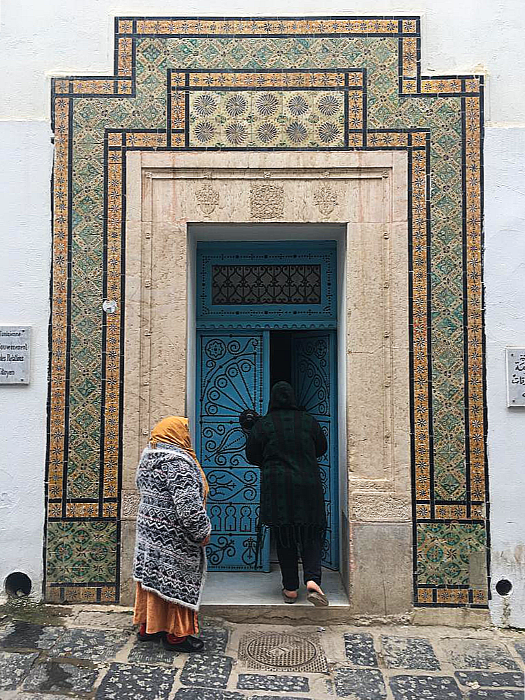 Tiles adorn the entrance to a building.