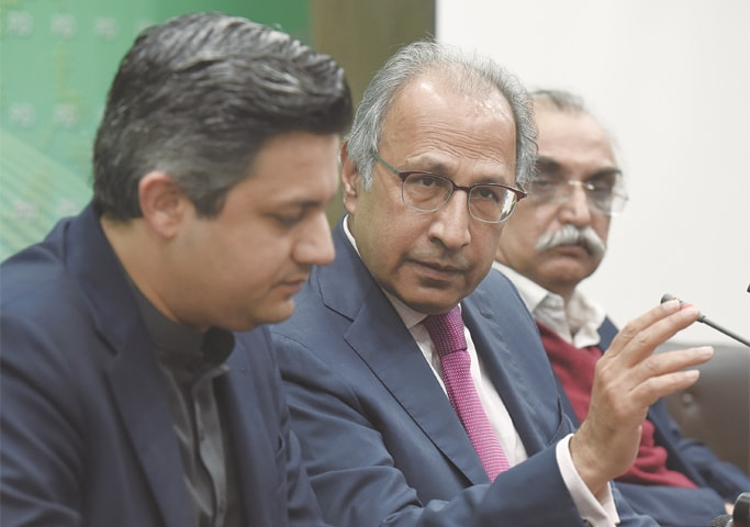 ADVISER on Finance Dr Abdul Hafeez Shaikh, Revenue Minister Hammad Azhar and FBR chairman Shabbar Zaidi addressing a press conference on Tuesday. —White Star