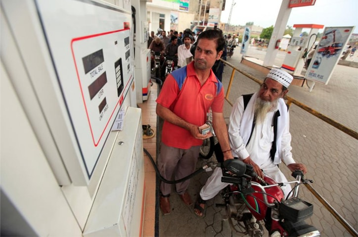 Motorcyclists wait in line at a fuel station in Rawalpindi in this file photo. Petrol sales during the 5MFY19 period jumped by 4pc.—Reuters