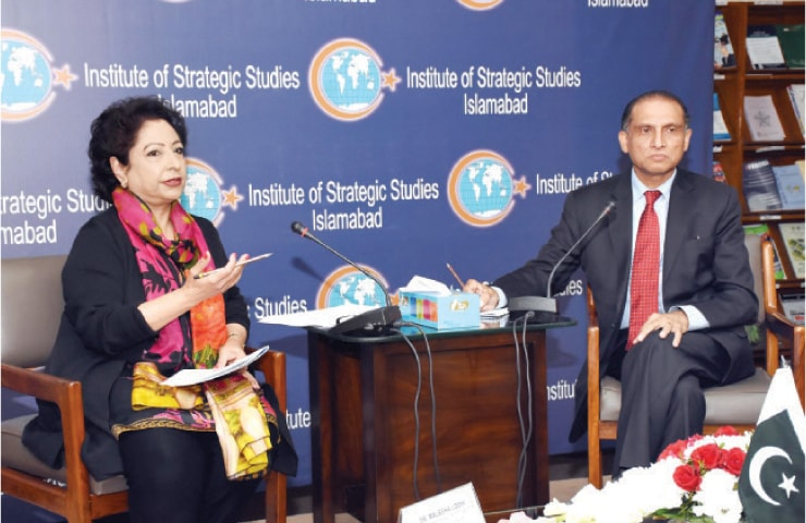 Pakistan's former permanent representative at the United Nations Maleeha Lodhi delivers a lecture on Wednesday. ISSI Director General Aizaz Ahmad Chaudhry is also seen. — Online