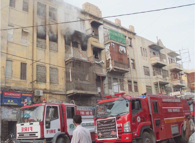 FIRE tenders arrive to put out the fire that erupted in Burhan Centre, near Regal Chowk, on Thursday.—Online