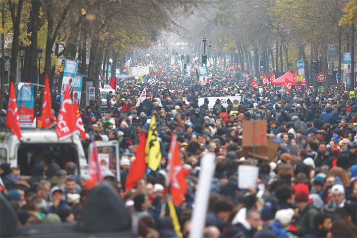 PARIS: Tens of thousands of people take part in a demonstration against pensions overhaul on Thursday.—AFP